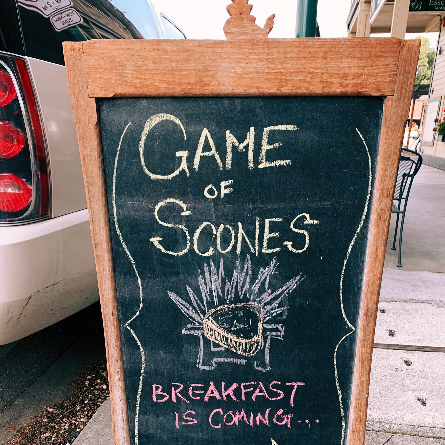 "chalkboard sign reading ""Game of Scones: breakfast is coming"""
